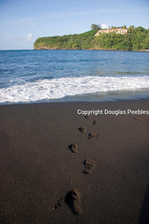 footprints, Mataiva Bay, black sand beach, Island of Tahiti, French Polynesia<br />