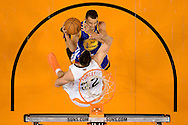 Dec 15, 2013; Phoenix, AZ, USA; Golden State Warriors guard Stephen Curry (30) goes up with the ball against the Phoenix Suns forward Miles Plumlee (22) in the first half at US Airways Center. The Suns defeated the Warriors 106-102. Mandatory Credit: Jennifer Stewart-USA TODAY Sports