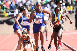 April 28, 2018 - Philadelphia, Pennsylvania, U.S - KENDRA CHAMBERS of the USA  falls as she passes the baton to DAINA HARPER, during the USA vs The World Women 4x400 at the 124th running of the Penn Relays in Philadelphia Pennsylvania (Credit Image: © Ricky Fitchett via ZUMA Wire)