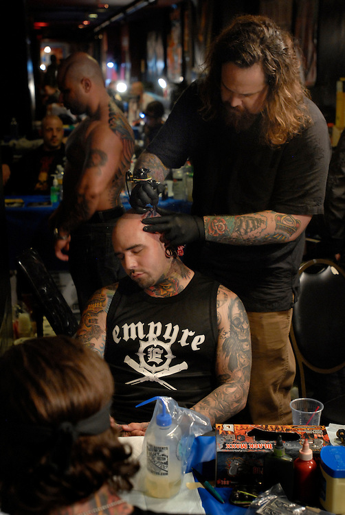 New York City Tattoo Convention 2009 at the Roseland Ballroom: Dana Helmuth from New York Adorned takes another scalp.