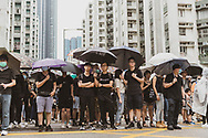 Crowds at a protest march in Whampoa, Hong Kong<br />