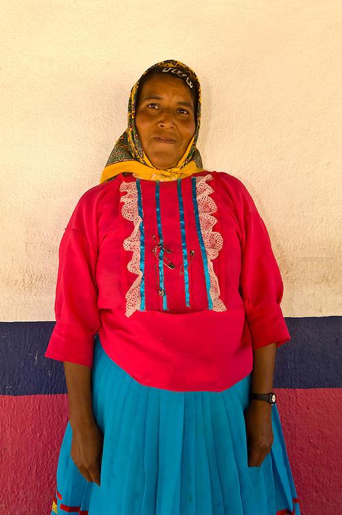 A Tarahumara Indian woman wearing her colorful native costume, Ejido San Alonso (near San Rafael), Copper Canyon, Mexico