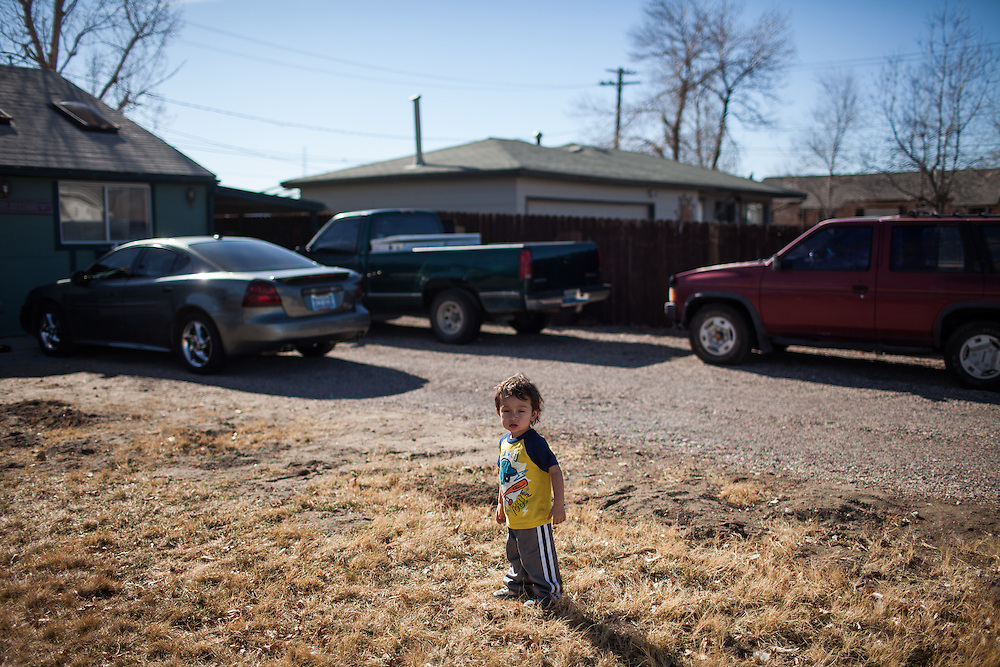 Two-year-old Jaxtin Lee plays in his front yard in Fallon, Nevada, February 5, 2014.