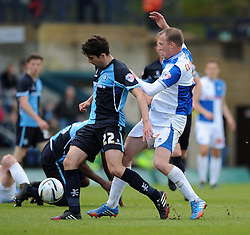 Bristol Rovers' David Clarkson closes down Wycombe Wanderers' Max Kretzschmar - Photo mandatory by-line: Dougie Allward/JMP - Mobile: 07966 386802 26/04/2014 - SPORT - FOOTBALL - High Wycombe - Adams Park - Wycombe Wanderers v Bristol Rovers - Sky Bet League Two