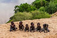 Kara tribe boys play at the edge of Dus village, overlooking the Omo River, Omo Valley, Ethiopia.