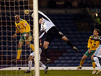 Photo: Jed Wee.<br /> Burnley v Norwich City. Coca Cola Championship. 24/03/2006.<br /> <br /> Norwich's Leon McKenzie (L) draws an acrobatic save from Burnley goalkeeper Brian Jensen.
