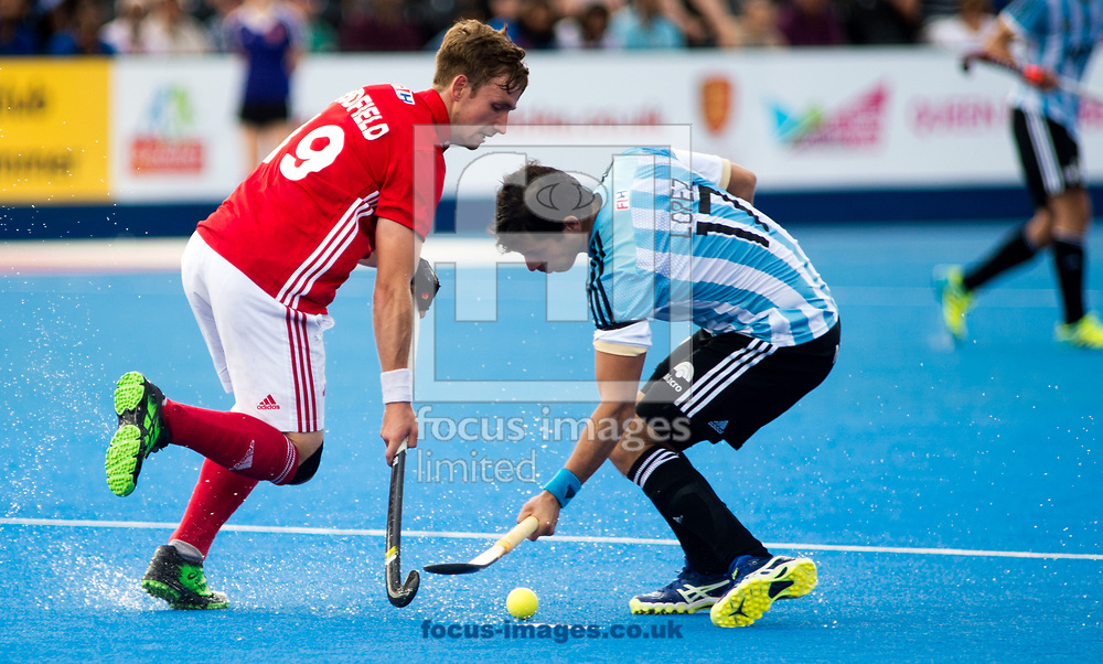 Juan Lopez of Argentina and David  Goodfield of England battle for the ball on day four of the Men's Hero Hockey World League Semi-Finals at Lee Valley Hockey Centre, Stratford<br /> Picture by Hannah Fountain/Focus Images Ltd 07814482222<br /> 18/06/2017