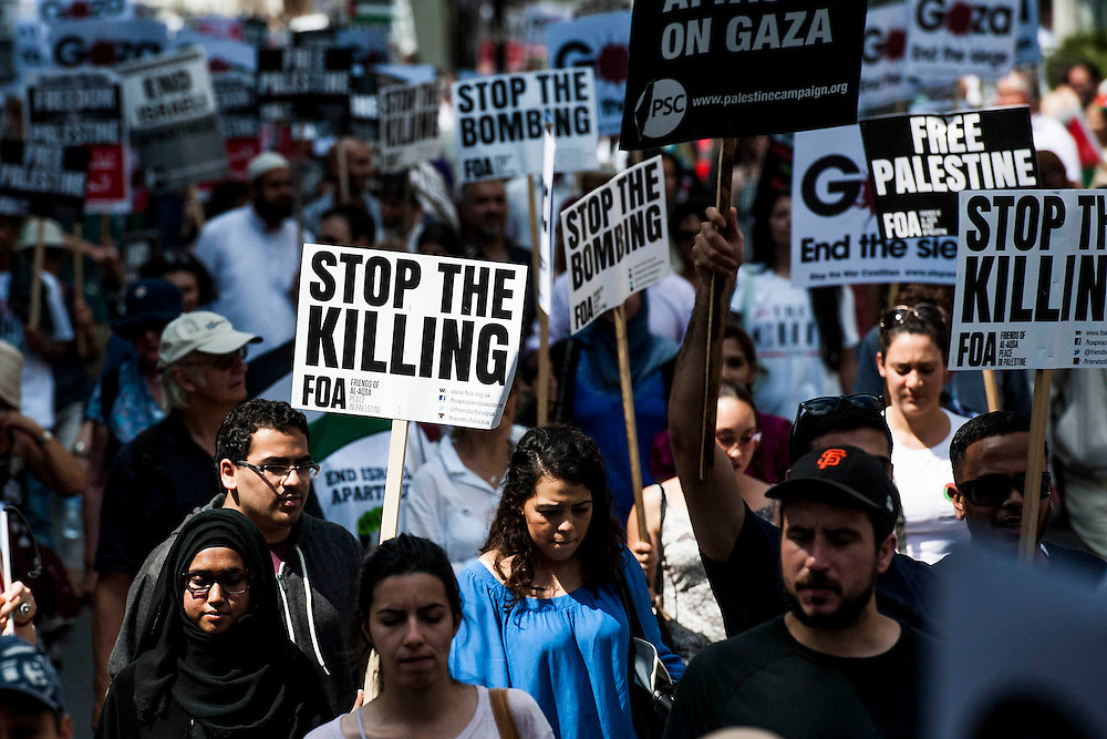 "Stop the 'massacre' in Gaza protest. A demonstration called by: Stop the War Coalition, Palestine Solidarity Campaign, Campaign for Nuclear Disarmament, Friends of Al Aqsa, British Muslim Initiative, Muslim Association of Britain, Palestinian Forum in Britain. They assembled at the Israeli Embassy and marched to Parliament. They called for ""Israel's bombing and killing to stop now and for David Cameron to stop supporting Israeli war crimes"". London, 26 July 2014. Guy Bell, 07771 786236, guy@gbphotos.com"