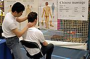 Nederland, Nijmegen, 2-3-2003..Chinese massage op een paranormaal beurs. Stress, ontspanning...New age, bijgeloof, alternatieve geneeskunde..gezondheid..Foto: Flip Franssen