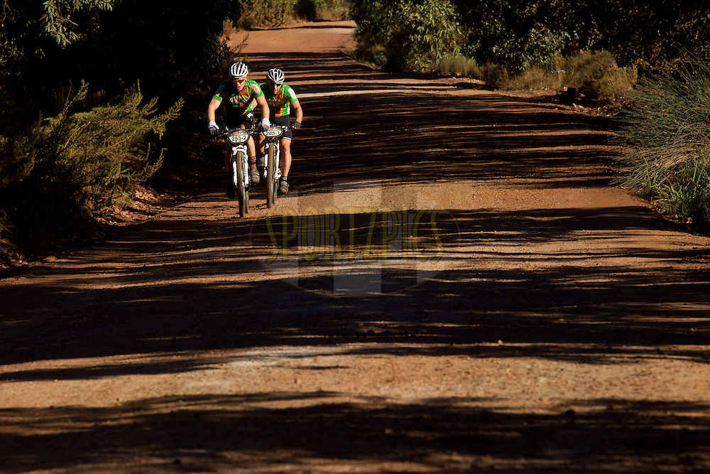 Franso Steyn and Petrus Malherbe during stage 6 of the 2012 Absa Cape Epic Mountain Bike stage race held in and around Oak Valley Wine Estate in the Elgin Valley, South Africa on the 31 March 2012..Photo by Greg Beadle/Cape Epic/SPORTZPICS