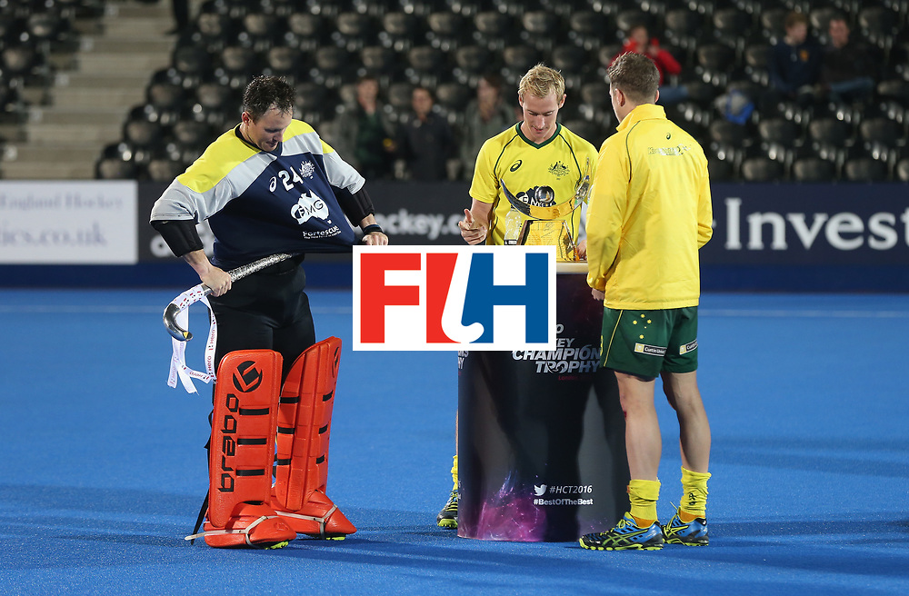 LONDON, ENGLAND - JUNE 17:  Tyler Lovell puts the trophy up his shirt before it has been presented during the FIH Mens Hero Hockey Champions Trophy 1st-2nd place match between Australia and India at Queen Elizabeth Olympic Park on June 17, 2016 in London, England.  (Photo by Alex Morton/Getty Images)
