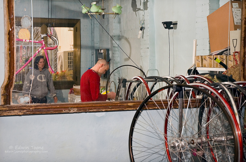 Dirk working on a bike in his home/shop before heading out to ride.