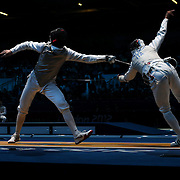 Race Imboden, USA, (left) in action against Andrea Baldini, Italy, in the Men's Foil Individual event during the Fencing competition at ExCel South Hall during the London 2012 Olympic games. London, UK. 31st July 2012. Photo Tim Clayton