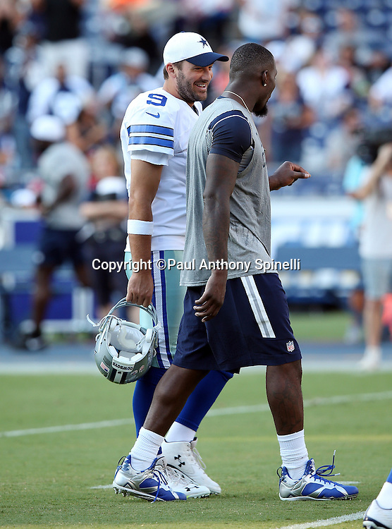 Dallas Cowboys quarterback Tony Romo (9) walks and laughs with Dallas Cowboys wide receiver Dez Bryant (88) before the 2015 NFL preseason football game against the San Diego Chargers on Thursday, Aug. 13, 2015 in San Diego. The Chargers won the game 17-7. (©Paul Anthony Spinelli)