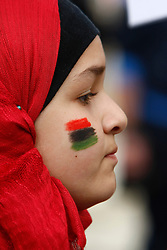 A young protestor with the flag of the Kingdom of Libya painted on her face takes part in a protest outside the Libyan Embassy in Attard, outside Valletta, February 22, 2011. The protest was organised by the Libyan community living in Malta against the Libyan government's crackdown on demonstrators in Libya..Photo by Darrin Zammit Lupi
