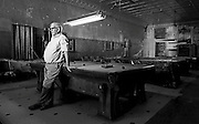 "Henry leans against one of the pool tables in ""The Palace"" a pool hall he owns in Pawhuska, OK."