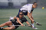 Northwestern University's Lacey Vigmostad (12), right, collides with Vanderbilt's Hannah Clark (16) in the pouring rain Friday afternoon March 23, 2012 at Lakeside Field on the Northwestern University Campus.  The number one Northwestern team defeated number eleven Vanderbilt 13-6.