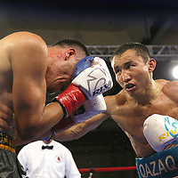 "Kanat ""QazaQ"" Islam of Almaty, Kazakhstan (R) beats  Noroberto ""Demonio"" Gonzalez of Monterrey, Mexico to win the NABO Jr. Middle Weight Title during a Nelsons Promotions boxing match at the Boca Raton Resort  and Club on Friday, May 26, 2017 in Boca Raton, Florida.  (Alex Menendez via AP)"