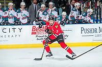 KELOWNA, CANADA - APRIL 8: Caleb Jones #3 of the Portland Winterhawks skates with the puck in front of the bench of the Kelowna Rockets on April 8, 2017 at Prospera Place in Kelowna, British Columbia, Canada.  (Photo by Marissa Baecker/Shoot the Breeze)  *** Local Caption ***