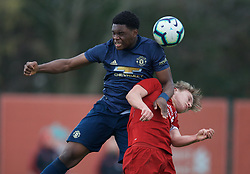 KIRKBY, ENGLAND - Saturday, January 26, 2019: Manchester United's Teden Mengi challenges Liverpool's captain Paul Glatzel during the FA Premier League match between Liverpool FC and Manchester United FC at The Academy. (Pic by David Rawcliffe/Propaganda)