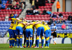 Derby County players gather in a huddle before kick off - Photo mandatory by-line: Matt McNulty/JMP - Mobile: 07966 386802 - 06/04/2015 - SPORT - Football - Wigan - DW Stadium - Wigan Athletic v Derby County - SkyBet Championship