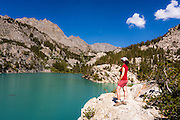 Hiker on the shore of Big Pine Lake #3, John Muir Wilderness, Sierra Nevada Mountains, California USA