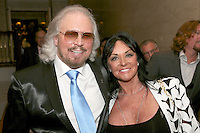 Barry Gibb, Linda Gray (Mrs Barry Gibb). The Silver Clef Lunch 2013 in aid of  Nordoff Robbins held at the London Hilton, Park Lane, London.<br /> Friday, June 28, 2013 (Photo/John Marshall JME)