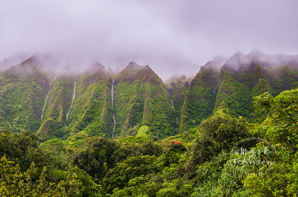 Waterfalls cascade down the vertical cliffs of the Koolau Mountains, Oahu, Hawaii
