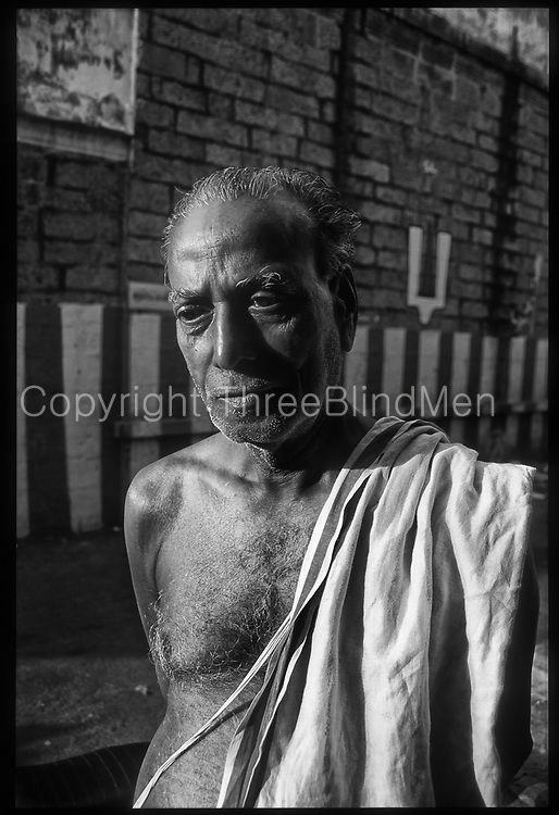 Brahmin Priest beside Temple Wall.Chennai. Tamil Nadu.
