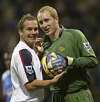 Photo: Aidan Ellis.<br /> Bolton Wanderers v Wigan Athletic. The Barclays Premiership. 04/11/2006.<br /> Bolton's Kevin Davis (L) shares a joke with Wigan's Chris Kirkland