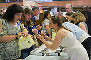 Huntington, New York, U.S. - August 6, 2014 - At the book signing for H. Clinton's new memoir, Hard Choices, at Book Revue in Huntington, Long Island, staff distribute numbered books that correspond with the numbers on patrons wristbands.