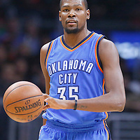 21 December 2015: Oklahoma City Thunder forward Kevin Durant (35) brings the ball up court during the Oklahoma City Thunder 100-99 victory over the Los Angeles Clippers, at the Staples Center, Los Angeles, California, USA.
