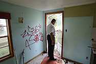 Hillsborough County Code Enforcement officer Manuel Acevedo walks through a home moments before demolition.  Acevedo was not happy with condemning the home but it had been abandoned by its owner and was drawing gang members and vagrants.