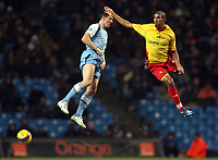 Photo: Paul Thomas.<br /> Manchester City v Watford. The Barclays Premiership. 04/12/2006.<br /> <br /> Joey Barton of Man City looses a header to Hamer Bouazza (R) of Watford.