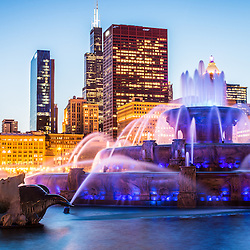 2012 high resolution photo of Chicago skyline at night with Buckingham Fountain and the Willis Tower skyscraper (Sears Tower). The Clarence F. Buckingham Memorial Fountain is a Chicago landmark and very popular attraction located in Grant Park in the downtown Chicago Loop.