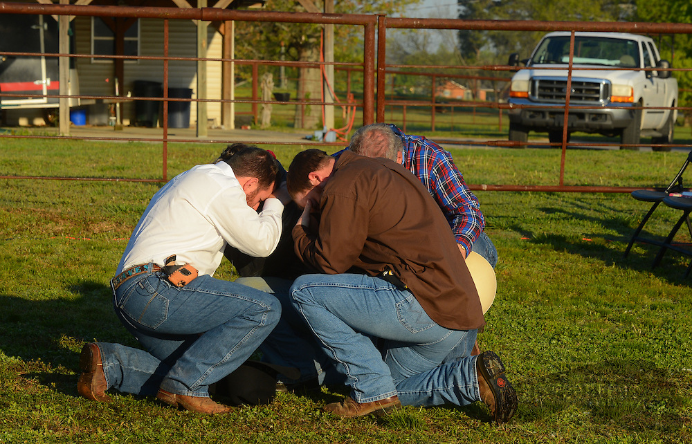 Gary Cosby Jr./Decatur Daily   Worshippers join together for a sunrise service at the No Fences Cowboy Church Easter Sunday morning in Falkville.  Pastor Josh Sparkman, lay pastor Chad Kelso and elder Van Giest pray with a person who came forward during the invitation.