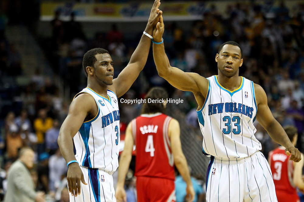 April 6, 2011; New Orleans, LA, USA; New Orleans Hornets point guard Chris Paul (3) and shooting guard Willie Green (33) celebrate in the final seconds of the fourth quarter against the Houston Rockets at the New Orleans Arena. The Hornets defeated the Rockets 101-93 and clinched a playoff spot with the victory.   Mandatory Credit: Derick E. Hingle-US PRESSWIRE