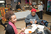 International students Tamara Jimah (left) and Keikotlhae Koodibetse (Right) enjoy a complimentary Thanksgiving lunch at the Atrium Cafe in Grover Center. Photo by Ben Siegel