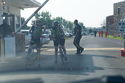 Two Gearing-Up instructors arrive on bikes at the main entrance of the prison facility in Holmsburg.