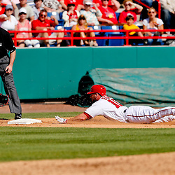 Mar 8, 2013; Melbourne, FL, USA; Washington Nationals left fielder Corey Brown (10) slides in past St. Louis Cardinals third baseman Patrick Wisdom during the bottom of the sixth inning of a spring training game at Space Coast Stadium. Mandatory Credit: Derick E. Hingle-USA TODAY Sports