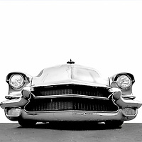 A very individualistic caddy.  There are not many Cadillacs with flames and pinstripes - they are more prominent in the color version of thei photo.