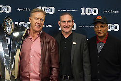 SANTA CLARA, CA - DECEMBER 05:  Pac-12 Commissioner Larry Scott stands with former Stanford Cardinal quarterback John Elway and former USC Trojans cornerback Ronnie Lott during a press conference before the Pac-12 Championship game between the Stanford Cardinal and the USC Trojans at Levi's Stadium on December 5, 2015 in Santa Clara, California. (Photo by Jason O. Watson/Getty Images) *** Local Caption *** Larry Scott; John Elway; Ronnie Lott