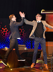 Repro Free: 27/06/2013 Eurovision hopeful Eoghan Quigg is pictured on the set of the Late Late Show getting a high-five from presenter Ryan Tubridy as the five acts competing to represent Ireland in this year's Eurovision in Copenhagen, Denmark met for the first time today. The five songs will be performed live on The Late Late Show tomorrow night on RTE One from 9:35. Picture Andres Poveda