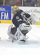 Notre Dame goaltender Mike Johnson kicks away one of the 46 shots he faced during Saturday's game against Lake Superior State in Sault Ste. Marie.