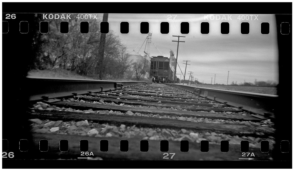 A train is seen on a railway line in Crawford, Texas, December 15, 2008. U.S. President George W. Bush moved to the small Texas town, population 705, in 1999 during his run for the presidency in 2000. The effect of the image was achieved by shooting 35mm black and white film in a medium format camera thereby exposing the entire negative including the sprocket holes of the film. REUTERS/Jim Young