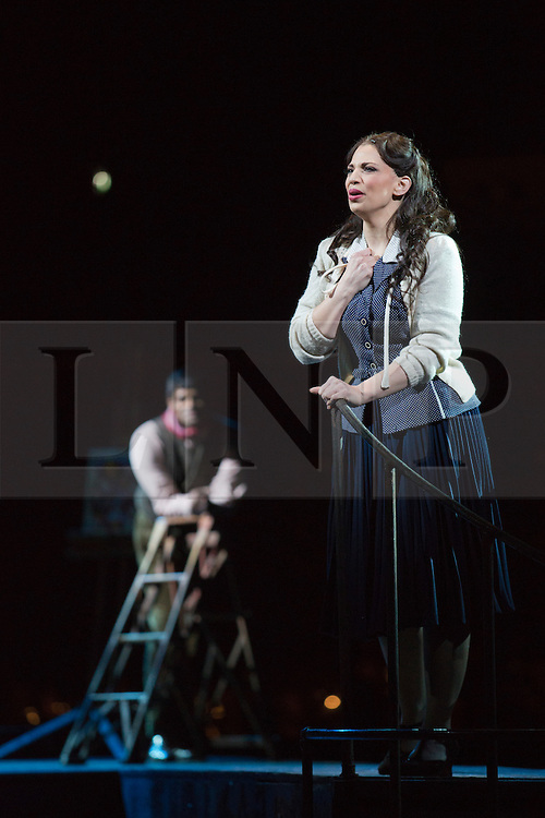 © Licensed to London News Pictures. 26 February 2014. London, England. Jessica Rose Cambio as Mimi and Sean Panikkar as Rodolfo. LA BOHÈME, Giacomo Puccini's masterpiece of doomed love and tragic passion, will play fourteen performances at the Royal Albert Hall, beginning on 27 February 2014. Francesca Zambello will direct, reviving her hugely successful 2004 production, music by the Royal Philharmonic Orchestra, a Ryamond Gubbay and RAH production. Dress rehearsal with Jessica Rose Cambio as Mimi and Sean Panikkar as Rodolfo. Photo credit: Bettina Strenske/LNP