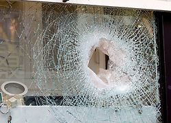 © Licensed to London News Pictures. 20/12/2011. London, United Kingdom .The smashed window after an attempted robbery on a jewellery shop on Oxford Street by persons on two motorbikes..Photo credit : Chris Winter/LNP