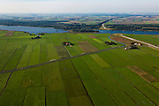 Nederland, Overijssel, Gemeente Kampen, 03-10-2010; Polder Dronten gezien naar Flevoland (boven), recht de tunnel voor de Hanzelijn onder het Dronter meer.  In het kader van het programma Ruimte voor de Rivier zijn er plannen om door de polders een nieuwe rivierloop aan te leggen: de Bypass Kampen. Eind van deze nieuwe waterweg, de uitstroom, ter hoogte van het van het eiland in het Dronter meer..Polder Dronten seen to  Flevoland, at the right the tunnel for the Hanzelijn under Dronter lake. There are plans to make a new river course through the polders, the Bypass Kampen (part of the project 'Space for the River'). End of this new waterway, the outflow, at the height of the island in the Dronter lake..luchtfoto (toeslag), aerial photo (additional fee required).foto/photo Siebe Swart