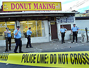 """Doughnut Crime Scene""--It seemed interesting to me that these three elements came together at the same time: a crime scene, cops and douhnuts. Very ironic. 3 people shot 1601 Pratt in the 15th police district. Police at the scene of a doughnut shop on Pratt near Frankford. One of the 3 people might be the shooter."