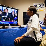 Supporters of mayoral candidate Nathan Fletcher watch David Alvarez speak soon after voting returns started to swing in Alvarez' favor.